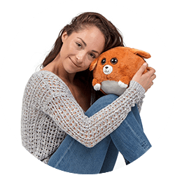 woman holding waggables plush